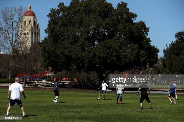 People play soccer near Hoover Tower on the Stanford University campus on March 12 2019 in Stanford California More than 40 people including...