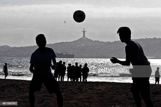 People play soccer on the beach on December 11 2014 in La Serena Chile La Serena is one of the eight host cities of Copa America Chile 2015
