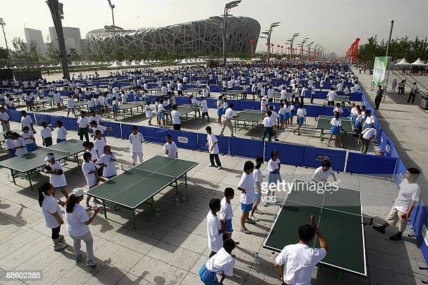 People play table tennis or pingpong near the Bird's Nest as the National Fitness Campaign kicks off on June 20 2009 in Beijing China The campaign...