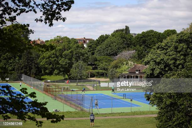 People play tennis at a Hove park on May 13 2020 in Hove United Kingdom The prime minister announced the general contours of a phased exit from the...