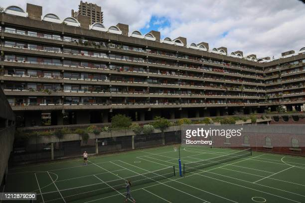People play tennis on the multipurpose sports courts on the Barbican estate in London UK on Wednesday May 13 2020 The UK will begin taking what Prime...