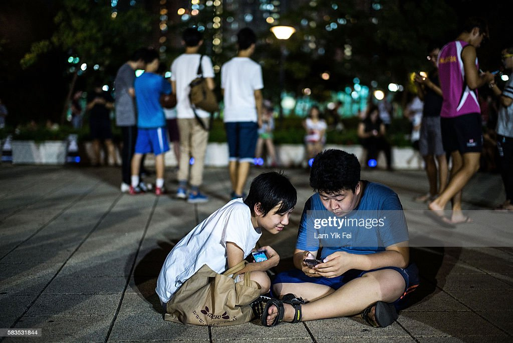 People play the Pokemon Go game at a park at Tin Shui Wai on July 26, 2016 in Hong Kong. 'Pokemon Go,' which has been a smash-hit across the globe was launched in Hong Kong on 25th July although shares in Nintendo Co tumbled on Monday after the company said the mobile game would not be a strong earnings driver.