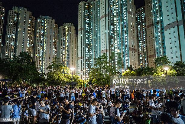 People play the Pokemon Go game at a park at Tin Shui Wai on July 26 2016 in Hong Kong 'Pokemon Go' which has been a smashhit across the globe was...