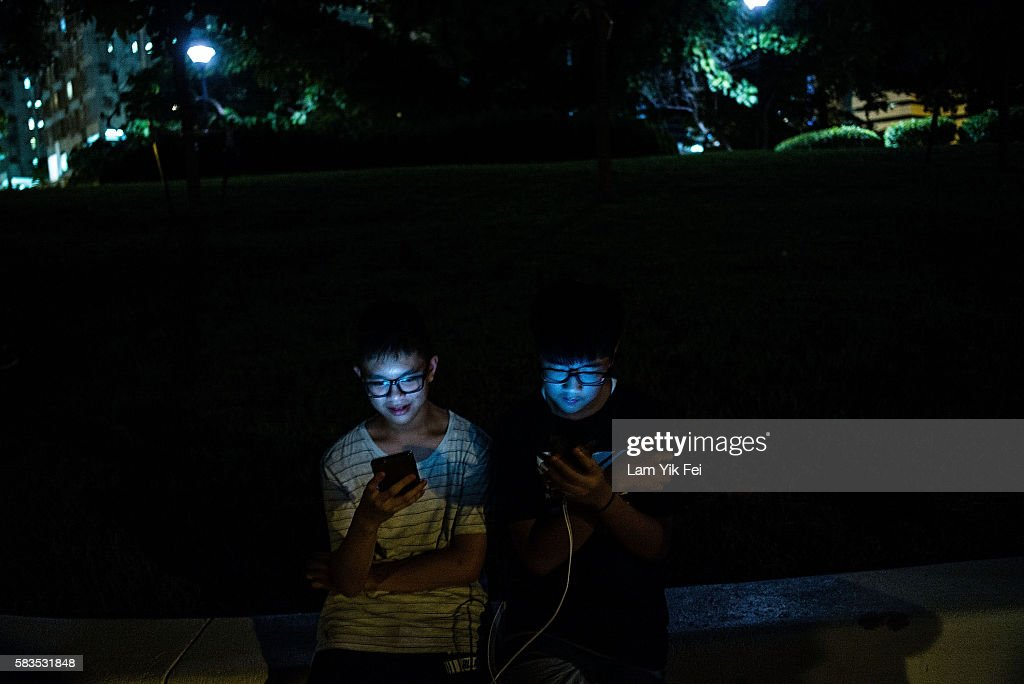People play the Pokemon Go game at a park at Tuen Mun on July 26, 2016 in Hong Kong. 'Pokemon Go,' which has been a smash-hit across the globe was launched in Hong Kong on 25th July although shares in Nintendo Co tumbled on Monday after the company said the mobile game would not be a strong earnings driver.