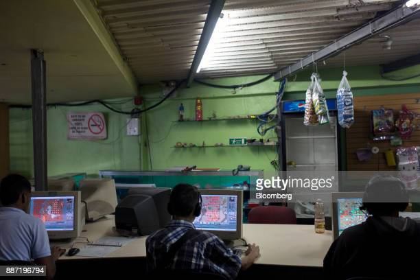 People play the Tibia video game on computers at a cybercafe in Caracas Venezuela on Tuesday Nov 28 2017 Crisiswracked Venezuela has become fertile...