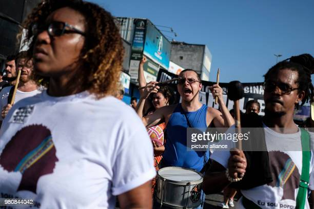 People play their drums during a demonstration in remembrance of Brazilian politician Marielle Franco who was assassinated on Wednesday in Rio de...