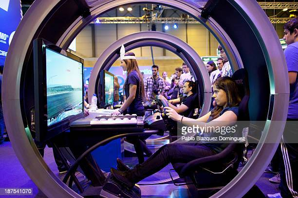 People play video games at Madrid Games Week in IFEMA on November 9, 2013 in Madrid, Spain. Madrid's first edition of the Games Week runs from...