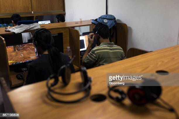 People play video games on computers at a cybercafe in Caracas Venezuela on Tuesday Nov 28 2017 Crisiswracked Venezuela has become fertile ground for...