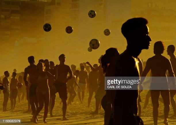 People play with balls at Ipanema Beach in Rio de janeiro Brazil on June 30 2019 Tourists from all over Latin America have arrived in Rio for the...