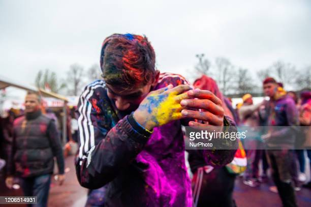 People play with colors during the Holi Festival celebration in The Hague, Netherlands, on March 10,2020. Millions of people around the world...