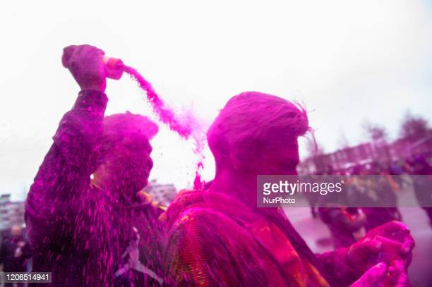 People play with colors during the Holi Festival celebration in The Hague Netherlands on March 102020 Millions of people around the world celebrate...
