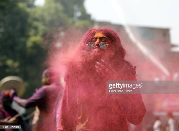 People play with colours and water as they celebrate Holi festival on March 20 2019 in Pune India Holi Festival also known as Spring Festival of...