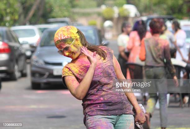 People play with colours as they celebrate Holi at Nirvana Country Sector 50 on March 10 2020 in Gurugram India