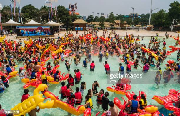 People play with crayfish inflatables at Playa Maya water park on June 17 2018 in Wuhan Hubei Province of China