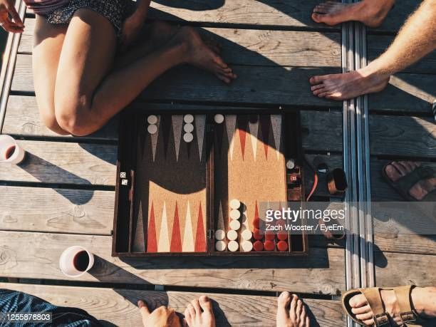 people playing backgammon at dusk - backgammon stock pictures, royalty-free photos & images