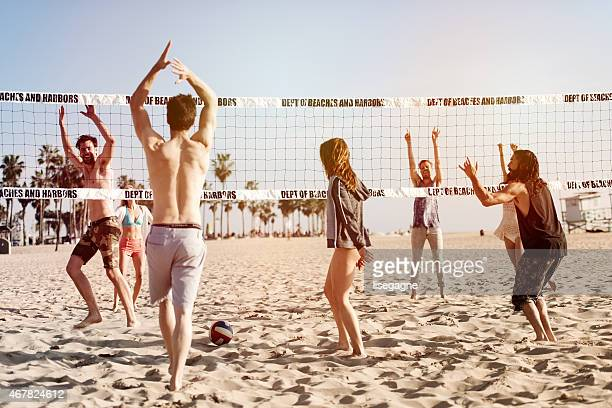 people playing beach volleyball - beachvolleybal stockfoto's en -beelden