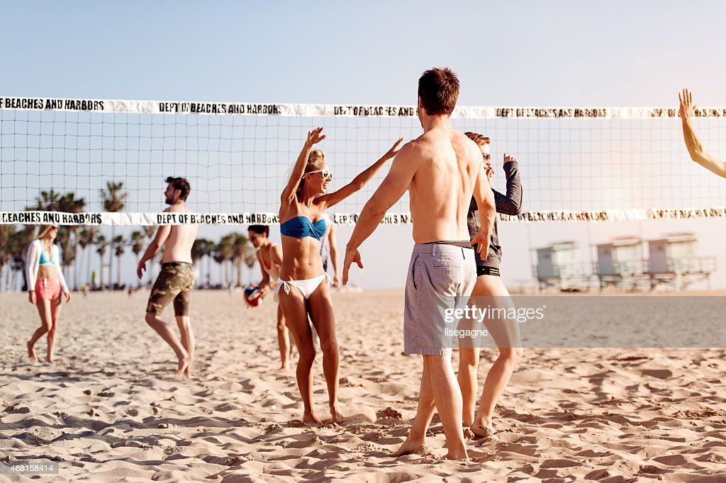 People playing beach volleyball : Stock Photo