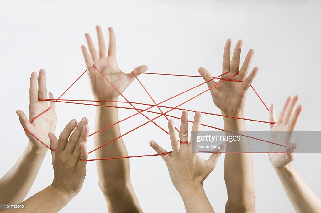 People playing cat's cradle : Stock Photo