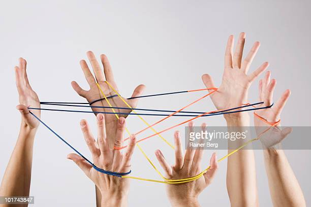People playing cat's cradle