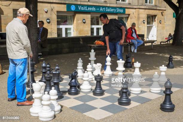 People playing chess outside Leeds central Library