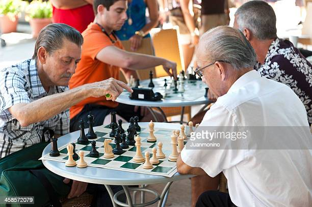 people playing chess - lincoln road stock pictures, royalty-free photos & images