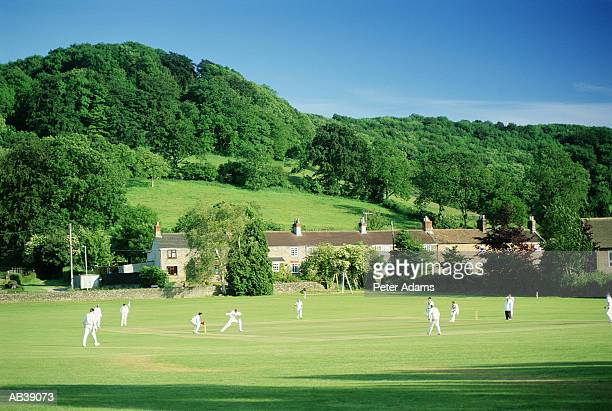 people playing cricket village green - england cricket stock pictures, royalty-free photos & images