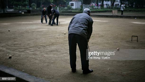 People Playing Croquet On Ground