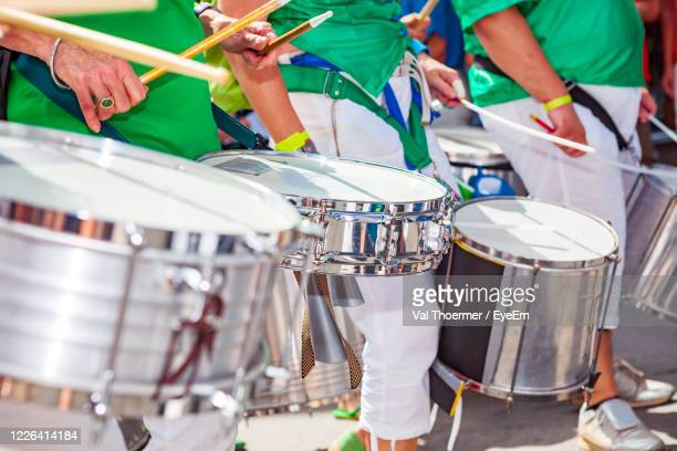people playing drums during event in city - samba stock pictures, royalty-free photos & images