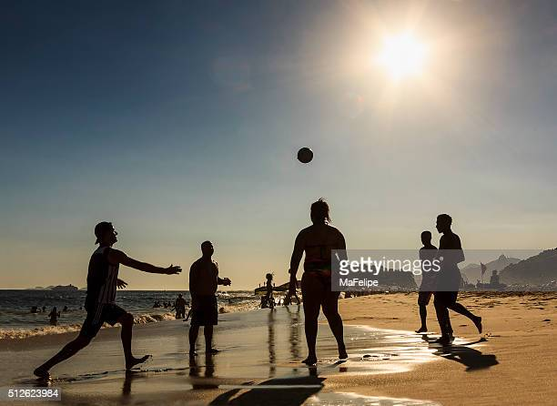 People Playing Football in a Beach