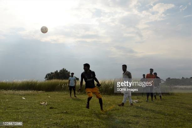 People playing football in a Kans grass field in Sarighat, on the outskirts of Dhaka. Kans grass field in Sarighat is one of the popular attractive...