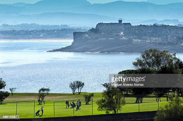 People Playing golf in Matalenas and fund Magdalena Palace in Santander, Spain