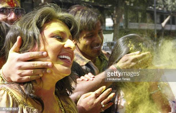 People playing holi with each other before the Holi festival on March 16 2014 in New Delhi India The festival falls on the last full moon day of...