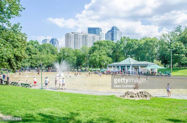 People playing in water of Boston Common Frog pond during summer day