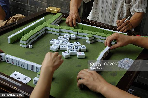people playing mahjong game - mahjong stock photos and pictures