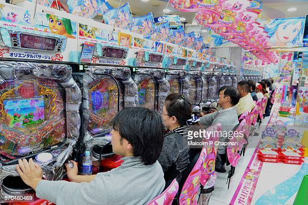 People playing Pachinko, Tokyo, Japan
