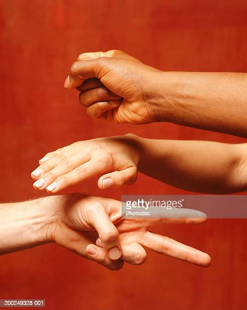 People playing rock paper scissors, (Close-up)