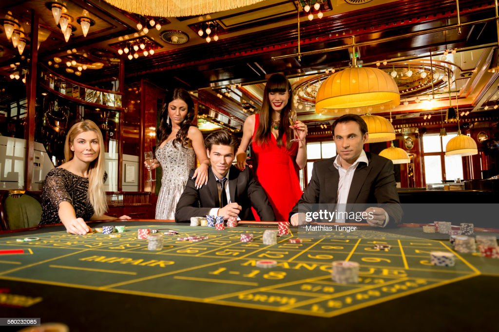 People playing roulette in a casino : Stock Photo