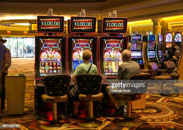 People playing slot machines at Caesars Palace Hotel Casino are viewed on May 29 2017 in Las Vegas Nevada Tourism in America's Sin City has within...