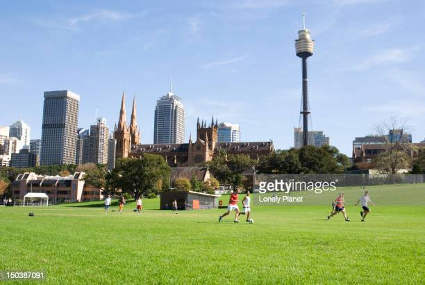 People playing soccer on the Domain.