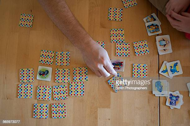 People playing tile game on wooden table
