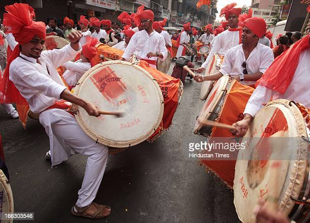 People playing traditional drums in procession being taken out at Girgaum on the occasion of Gudi Padwa, Marathi New year on April 11, 2013 in...