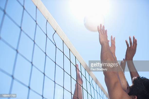 people playing volleyball - beachvolleybal stockfoto's en -beelden