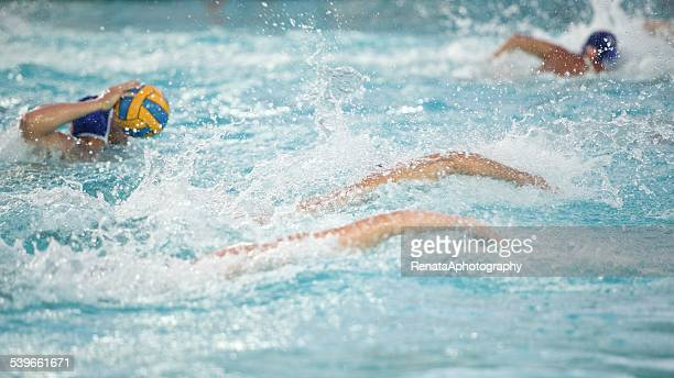 people playing waterpolo in swimming pool - water polo stock pictures, royalty-free photos & images