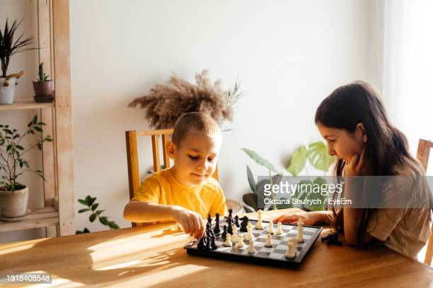 people playing with baby at home - game night leisure activity stock pictures, royalty-free photos & images
