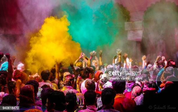 People Playing With Powder Paint On Street During Holi