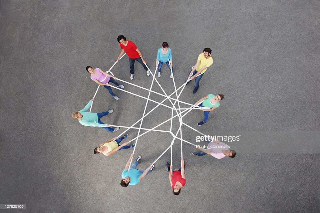 People playing with tangled string : Stock Photo