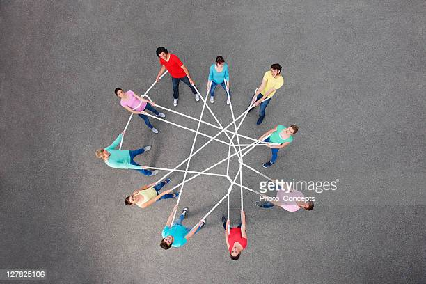 people playing with tangled string - circle stock pictures, royalty-free photos & images