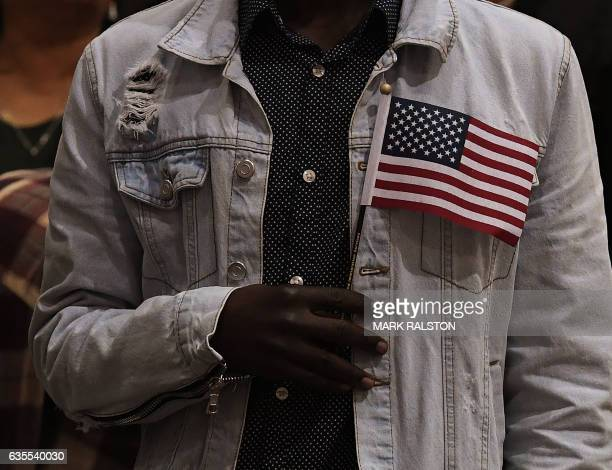 TOPSHOT People pledge allegiance to the United States of America as they receive US citizenship at a naturalization ceremony for immigrants in Los...