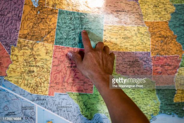 People point out where they are going next on a map at a migrant shelter run by Catholic Community Services of Southern Arizona Inc on Thursday Jan...