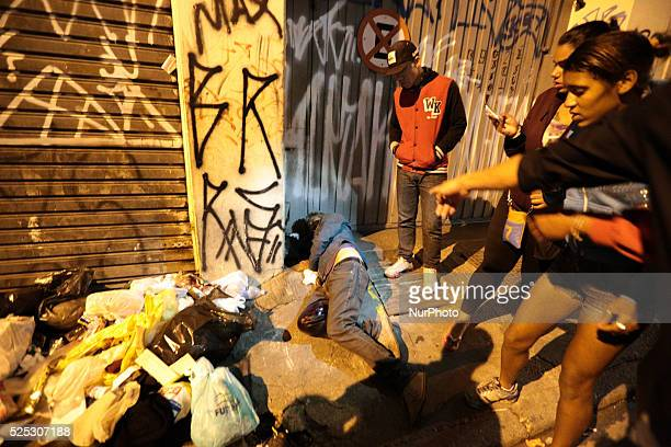 People point to a man who has been wounded in the back and in the leg by rubber bullets fired by the police after an eviction ended in violent...